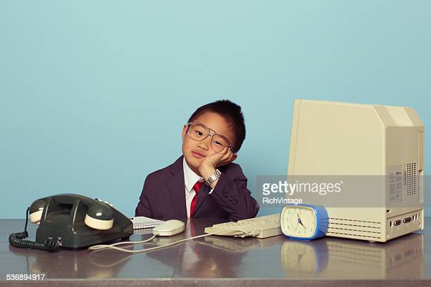 Young Japanese Boy Tired at the Office