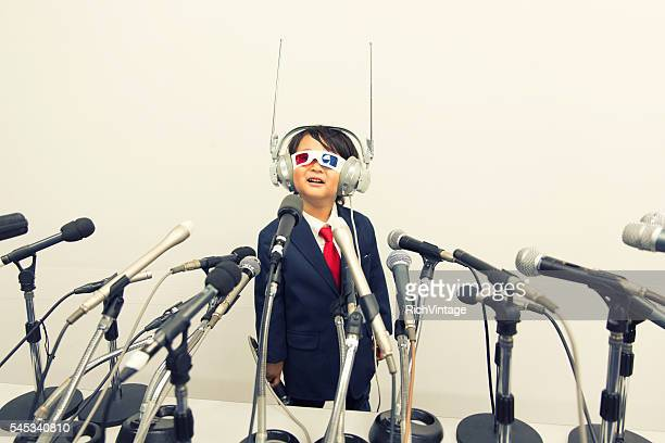 Young Japanese Boy with Headset and Microphones