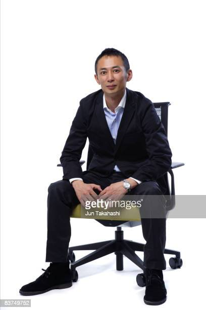 Young Japanese businessman sitting on the chair