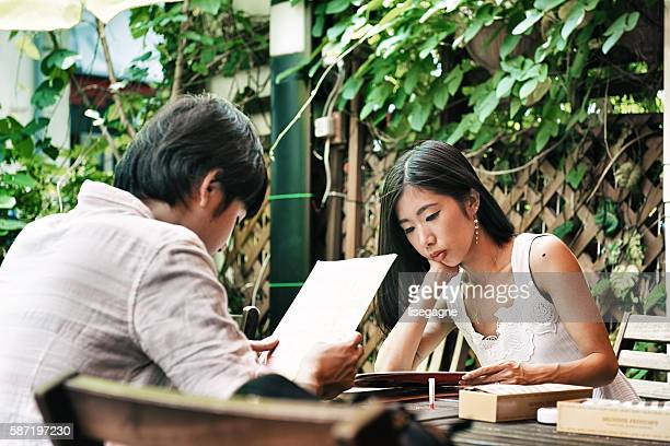 Young Japanese couple on a terrace