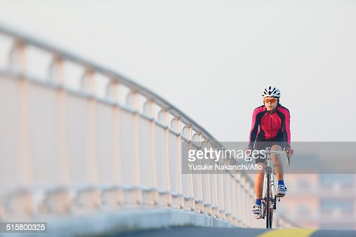 Young Japanese girl cycling