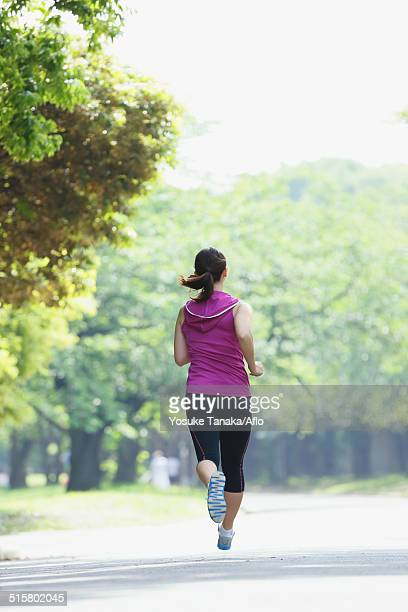 Young Japanese girl running in the park