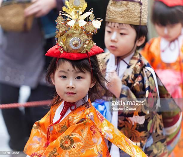 young japanese girl wearing traditional celebrator