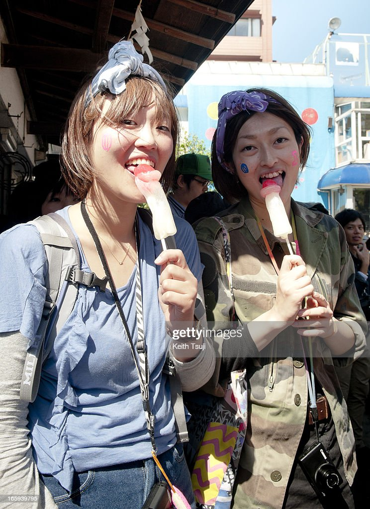 Young Japanese girls eat phallic-shaped candy lollipops at Kanamara Matsuri (Festival of the Steel Phallus) on April 7, 2013 in Kawasaki, Japan. The festival is held annually on the first Sunday of April and it is centered around a local penis-venerating shrine once popular among prostitutes who wished to pray for protection from sexually transmitted diseases. The festival is now a popular tourist attraction.
