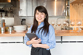 Young japanese lady manager of cafe restrant