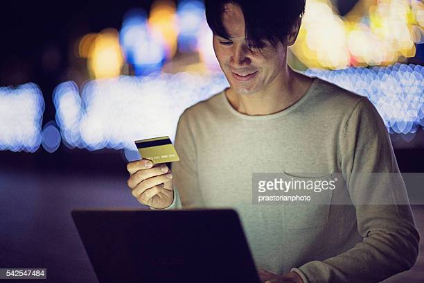 Young Japanese man is  shopping online