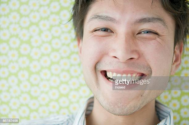 Young Japanese man smiling, portrait