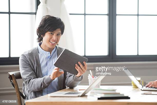 Young Japanese man with digital tablet