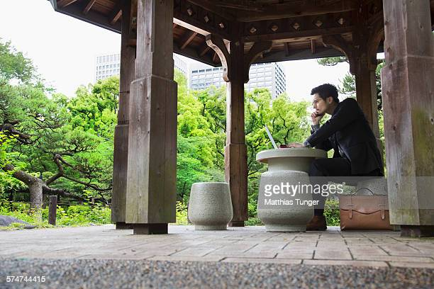 Young Japanese man working in a park