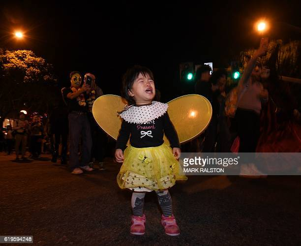 A young Japanese tourist from Tokyo dressed in colorful Halloween costume parades along Santa Monica Blvd during the annual street Halloween festival...