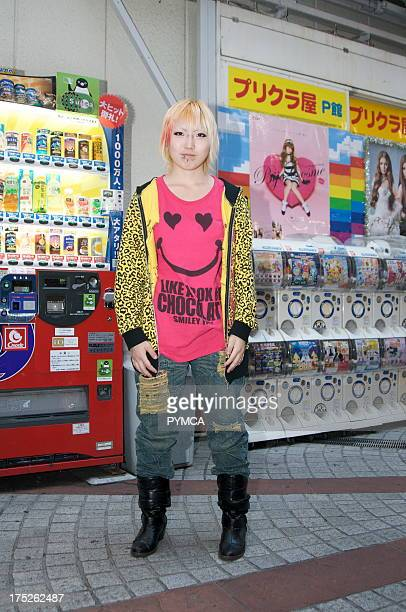 A young Japanese woman shopping in the Harajuku area of Tokyo Japan