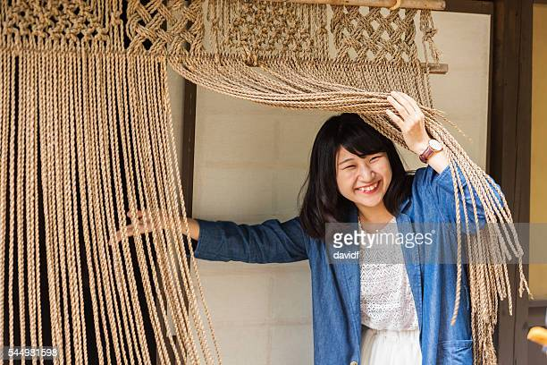 Young Japanese Woman Welcomes a Guest at a Traditional House