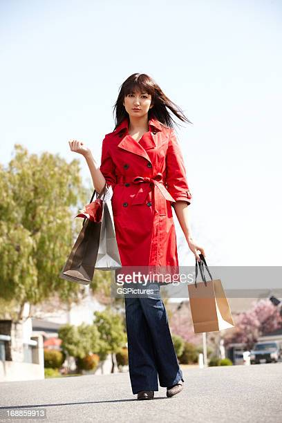 Young Japanese woman with shopping bags outdoors