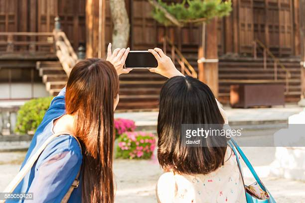 POV Young Japanese Women Taking Smartphone Selfie at Temple