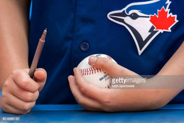 A young Jays fan waits patiently for autographs before the regular season MLB game between the Los Angeles Angels of Anaheim and the Toronto Blue...