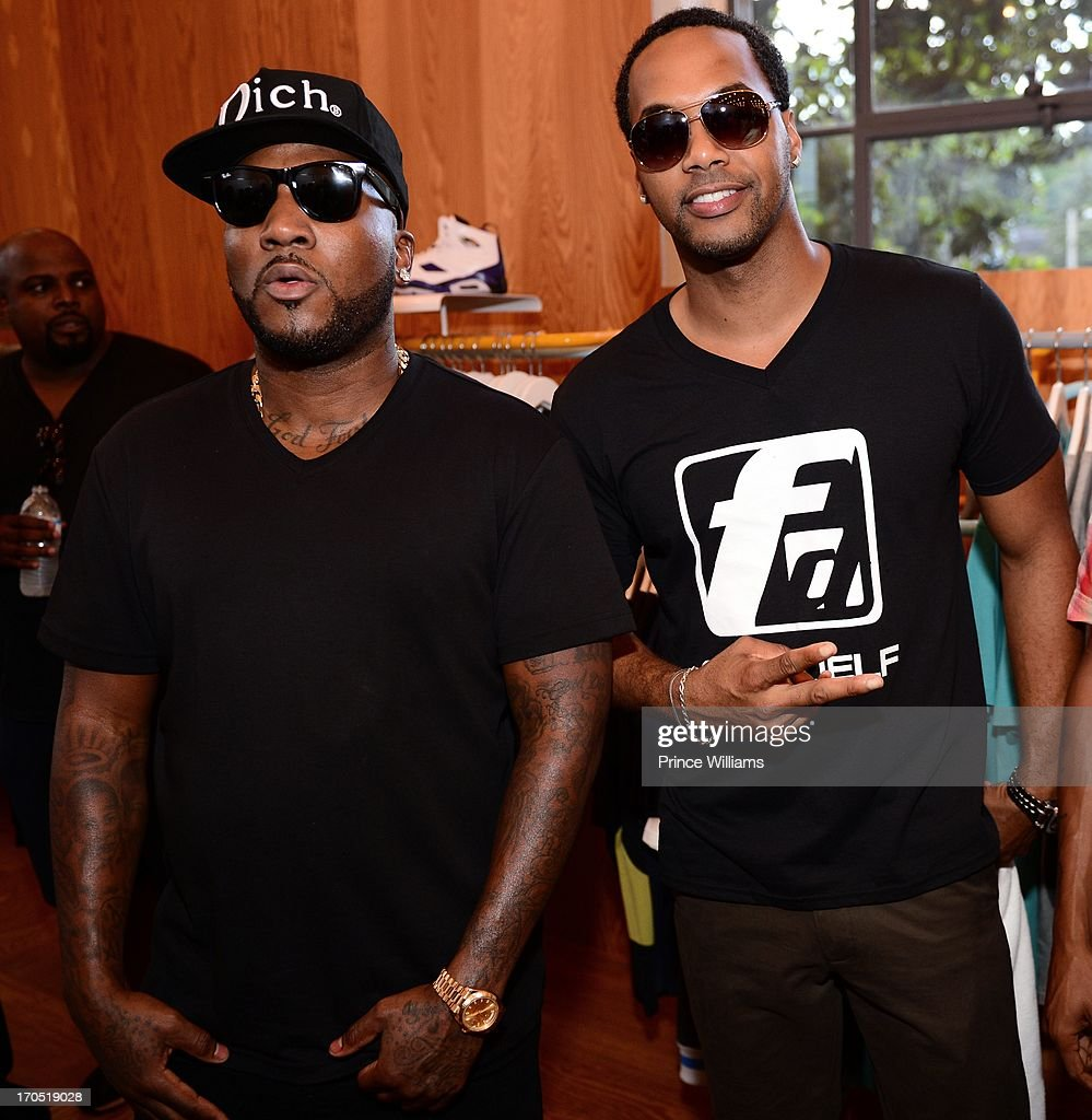 Young Jeezy and DJ Fadelf attends the Young Jeezy and Gourmet Footwear branding partnership launch at Wish Shoe Store on June 13, 2013 in Atlanta, Georgia.