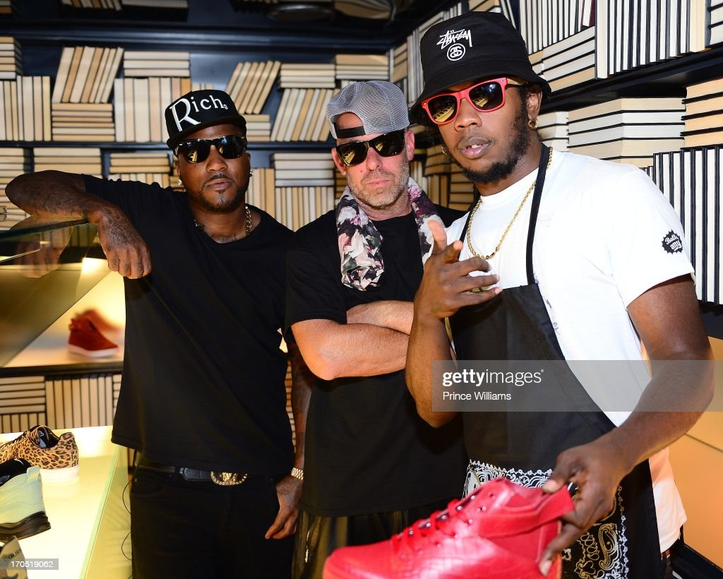 Young Jeezy Gregory Lucci and Trinidad James attend the Young Jeezy and Gourmet Footwear branding partnership launch at Wish Shoe Store on June 13...