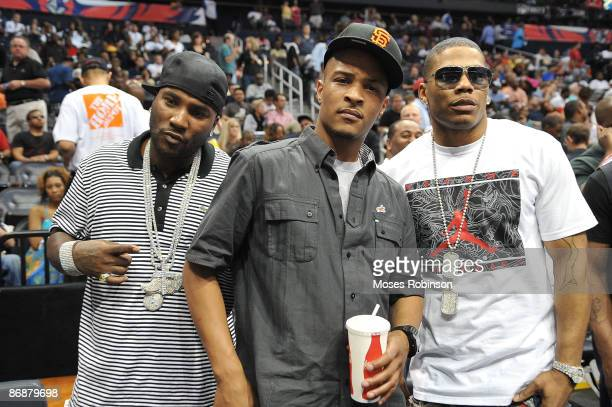 Young Jeezy TI and Nelly attend the Cleveland Cavaliers and Atlanta Hawks Playoff Game 4 at Philips Arena on May 9 2009 in Atlanta Georgia