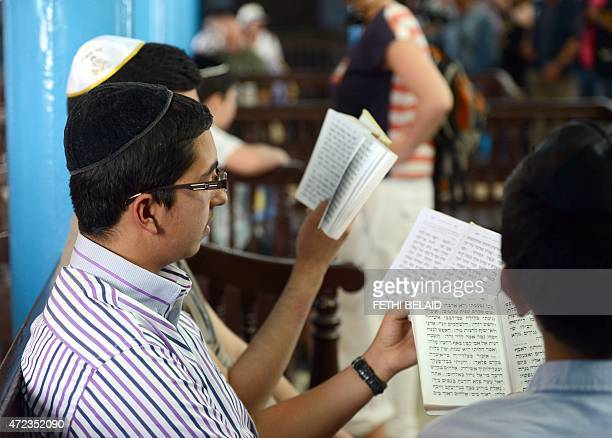 A young Jewish man reads the Torah Judaisms most important text at the Ghriba synagogue on the Tunisian resort island of Djerba on May 6 at the start...