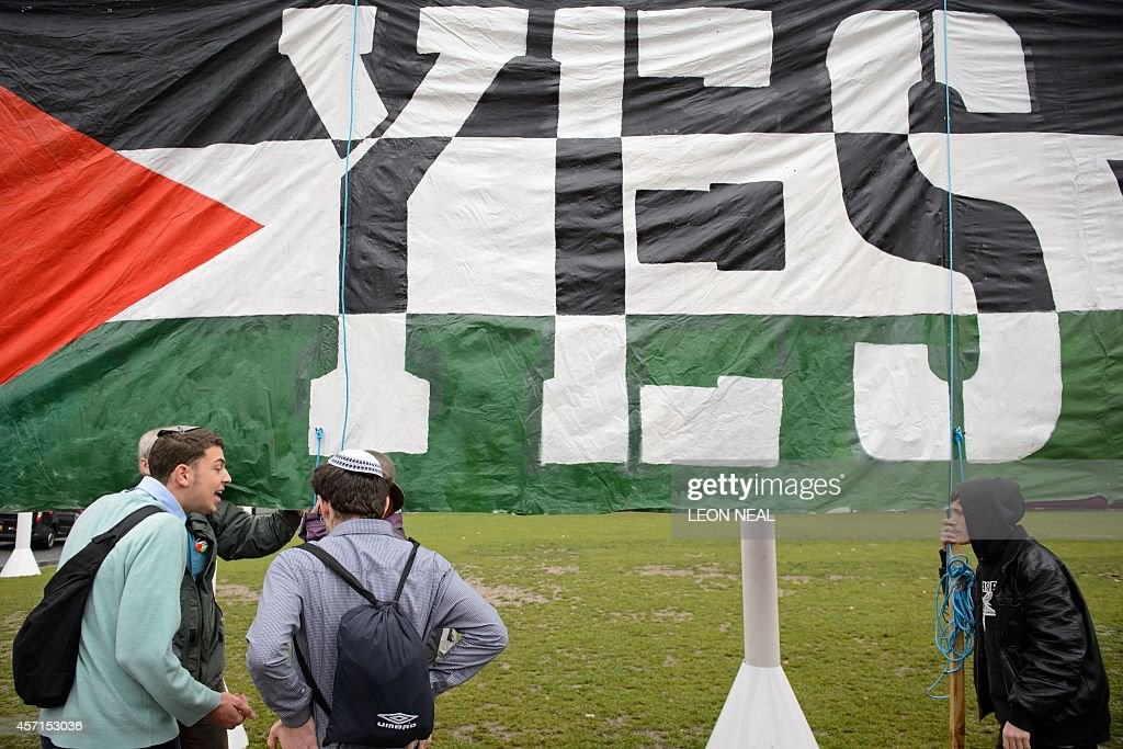 Young Jewish men argue with ProPalestinian supporters beside a giant banner calling for a recognised Palestinian State in Parliament Square central...