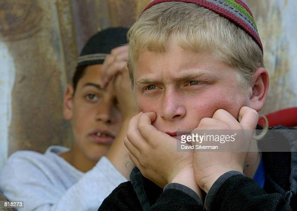 Young Jewish settlers hold their religion class March 27 2001 close to the spot where 10monthold Shalhevet Pass was shot to death by a Palestinian...