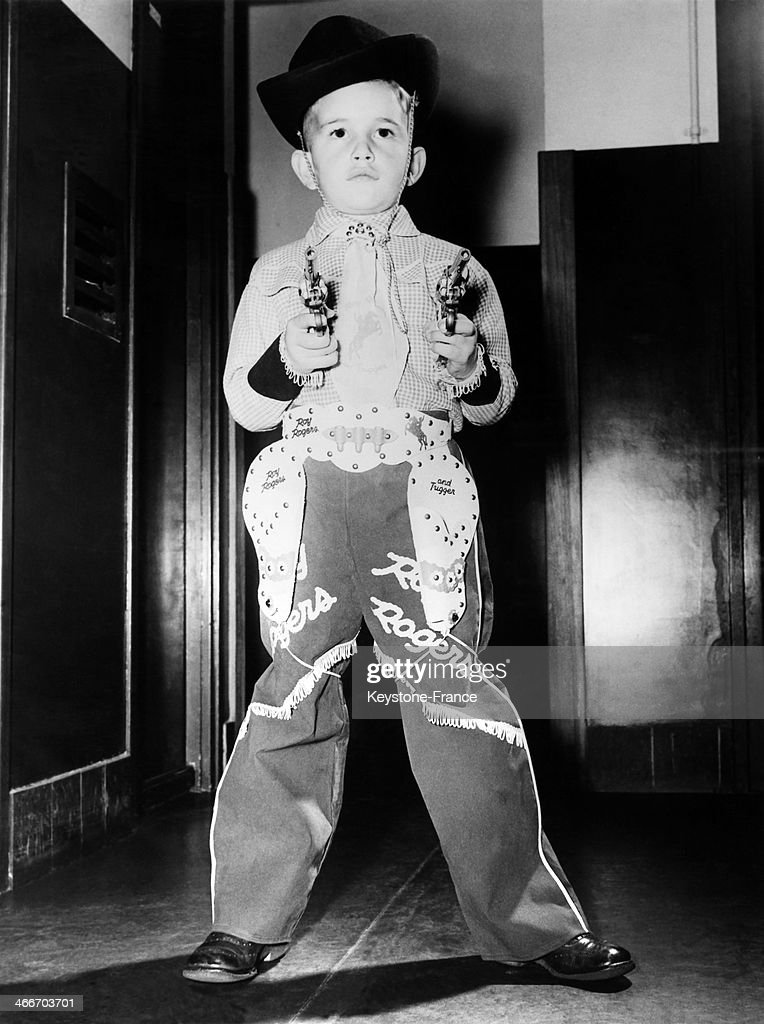 Young Johnny, 8, looking like a small edition of famous cowboy Roy Rogers in his new outfit, on October 31, 1953 in United States.