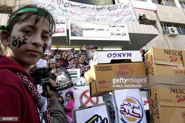 A young Jordanian protester attends a demonstration organised by the Jordan Professional Associations against Israel's Gaza operation in Amman on...