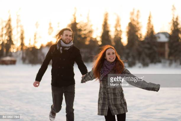 Young joyful couple enjoying winter season