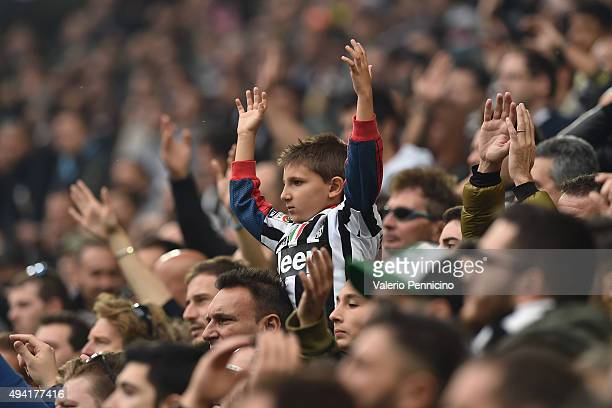 A young Juventus FC fan shows his support during the Serie A match between Juventus FC and Atalanta BC at Juventus Arena on October 25 2015 in Turin...