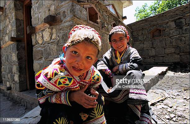 Young Kalash Girls In Pakistan In 2001Young Kalash girls in front of a building 'offered' by a Greek association who by their various actions alter...