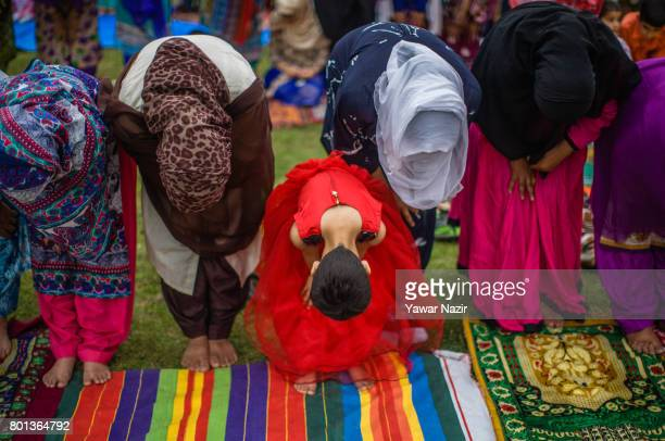 A young Kashmiri Muslim girl offer congregational EidulFitr prayers with other Muslim women at Eid Gah on Eidulfitr a festival of Muslims on June 26...