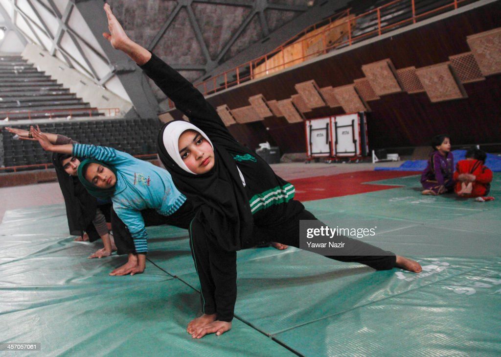 Young Kashmiri Muslim girls practice inside indoor stadium on December 16, 2013 in Srinagar, the summer capital of Indian administered Kashmir, India. As the number of crimes against women has risen in the region, girls from different age groups and backgrounds have taken up martial arts and other self defence courses to thwart attackers. Many believe after the barbaric rape and murder of a para-medic student last year on this day in the Indian capital of New Delhi, women in the Muslim majority state have taken to various martial arts forms like Thang-ta, a weapon-based Indian Martial art for protection.