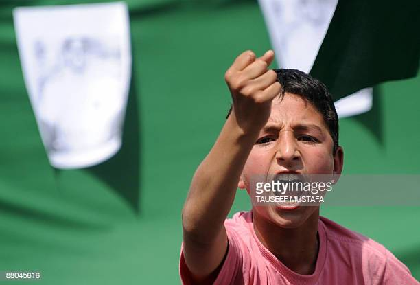 A young Kashmiri shouts profreedom slogans during a protest in downtown Srinagar on May 29 2009 Prominent separatist leader Syed Ali Shah Geelani was...