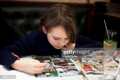 young kid reading an exciting story