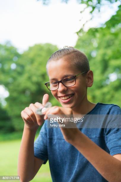 Young kid using fidget spinner