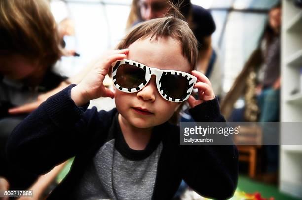 Young Kid Wearing Zebra Sunglasses.