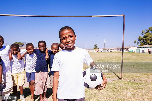 Young kids on a soccer team on a sunny day