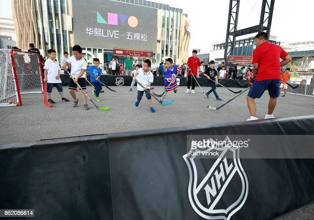 Young kids play hockey at the NHL Fan Fest before the preseason game between the Los Angeles Kings and the Vancouver Canucks at Cadillac Arena...