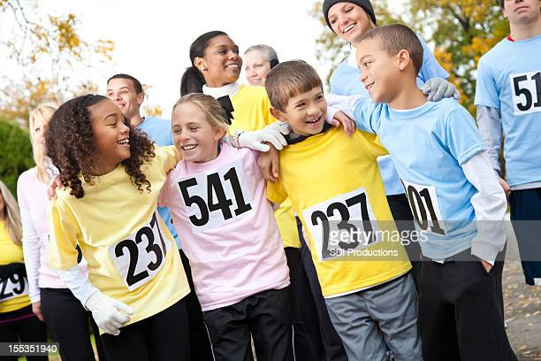 Young kids walking in a charity event race together