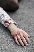 Young killed man lying on the street