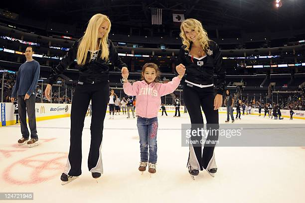 A young Kings fan skates with two members of the Ice Crew as the Los Angeles Kings host LA Kings Hockey Fest '11 on September 11 2011 at Staples...