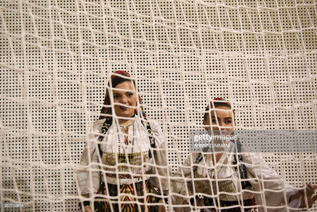 Young Kosovo Albanian women wearing traditional costumes take part in a celebration of Kosovo's admission to UEFA, on May 3, 2016 in Mitrovica. UEFA admitted Kosovo as its 55th member in a narrow vote on May 2, boosting its hopes of competing in the 2018 World Cup despite warnings from former ruler Serbia. / AFP / ARMEND