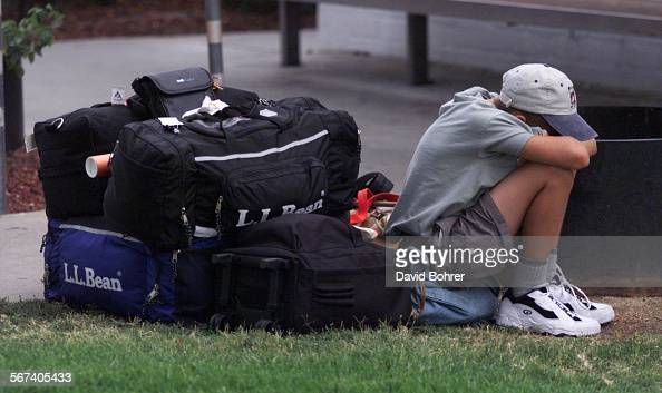 A young Labor Day weekend traveler waits with the family's luggage at the Flyaway Bus Terminal in Van Nuys where they will take the bus to LAX as...