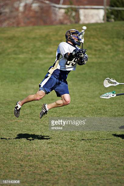 Young Lacrosse Player Jumps and Shoots with copy space