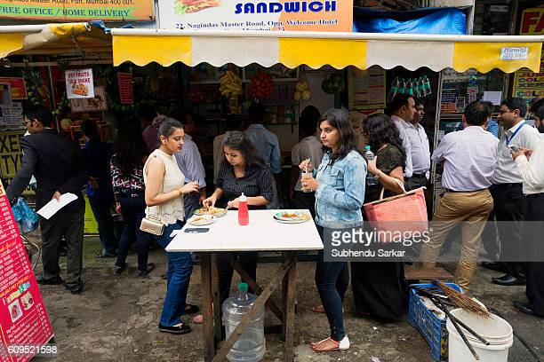 Young ladies take a quick lunch at a street food joint Mumbai is often called a dream city and the financial capital of the country where people from...