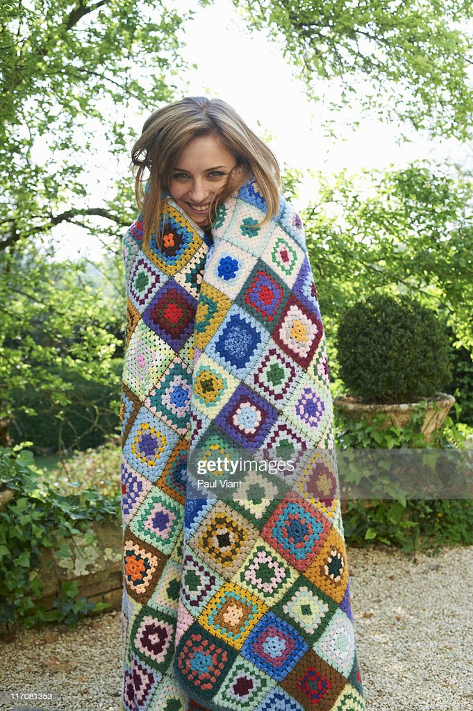 young lady [24-26] in blanket smiling
