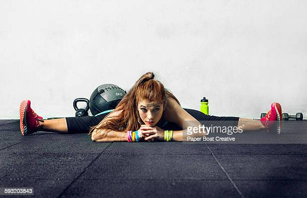 Young lady doing splits in the sports studio