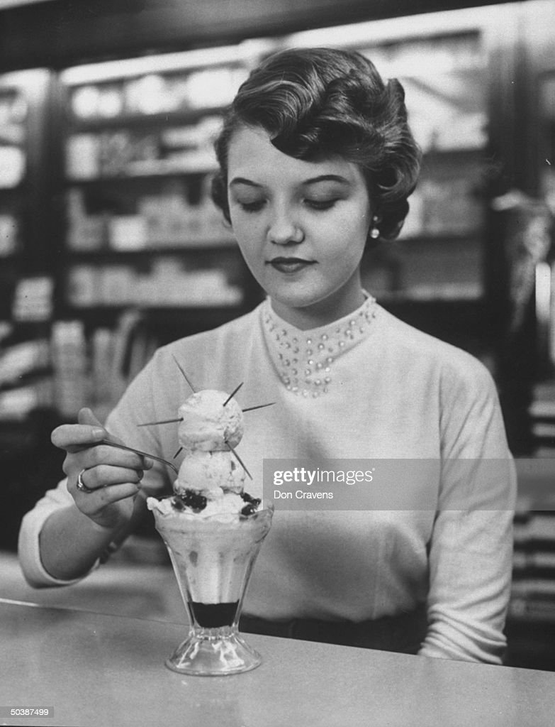Young lady eating a Sputnik sundae.