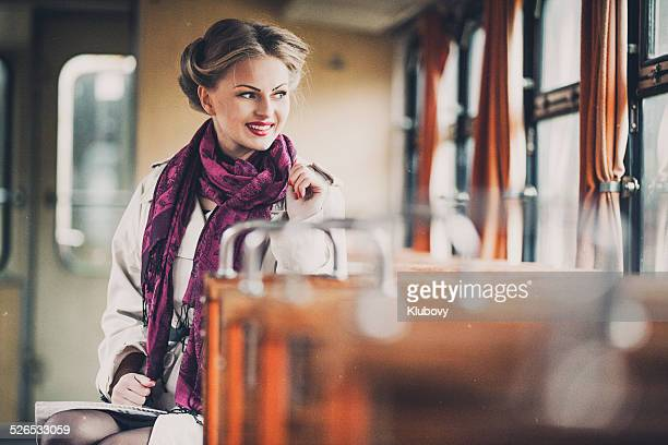 Young lady in a vintage train wagon