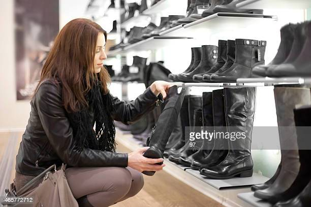Young lady looking at boots in a boutique
